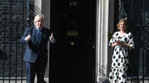 Prime Minister Boris Johnson and Annemarie Plas, founder of Clap For Our Carers, outside 10 Downing Street (Victoria Jones/PA)