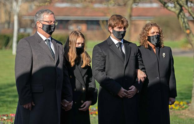 (l to r) Son-in-law Colin Ingram, granddaughter Georgia, grandson Benjie and daughter Hannah Ingram-Moore were among the mourners (Joe Giddens/PA)