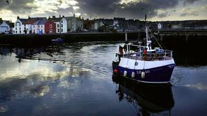 A trawler bringing in its catch at Eyemouth harbour, in the Scottish Borders. (PA/David Cheskin)
