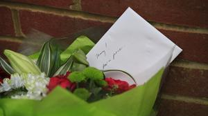 Flowers left outside the home of Sir Terry Wogan in Taplow, Buckinghamshire