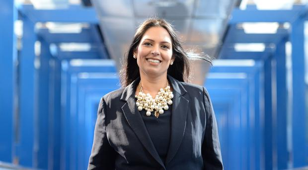 Priti Patel has dismissed suggestions that the Duchess of Sussex has been subjected to racist press coverage (PA)