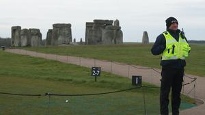 A security guard stands on a footpath near Stonehenge (Adam Davy/PA)