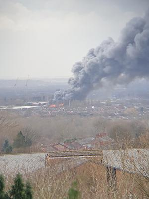 A plume of smoke earlier rising from the warehouse fire in Holland Street, Denton, Manchester (@Miraaaaa87/PA)