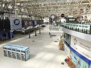 The concourse at London's Waterloo station at midday (Jonathan Brady/PA)