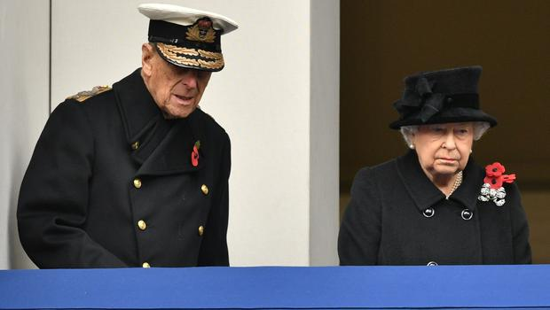 The Queen and the Duke of Edinburgh observe the annual Remembrance Sunday Service at the Cenotaph memorial from a balcony in Whitehall (Dominic Lipinski/PA)