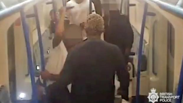 Still of two men involved in a violent knife fight on the London Underground (BTP/PA)