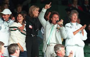 Sir Cliff Richard leads the community singing on Centre Court at Wimbledon in 1996 (Adam Butler/PA)