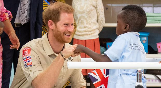 Harry could not resist kneeling down and giving six-year-old Barnaby Jose Mar a fist-bump (Dominic Lipinski/PA)