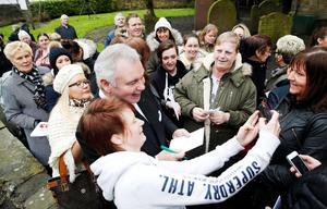 This Morning presenter Eamonn Holmes has his picture taken with members of the public following the funeral of TV agony aunt Denise Robertson