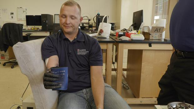 Retired US Army Sergeant Garrett Anderson tries out the technology with his prosthetic arm (Northwest University/PA)