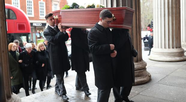 The casket containing the remains of Frank Dobson is carried into St Pancras Church (Yui Mok/PA)