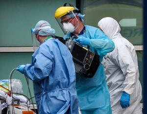 Paramedics and staff at the Royal Liverpool University Hospital wearing various items of PPE (Peter Byrne/PA)