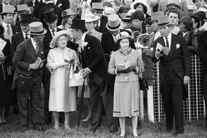 The Queen and the Queen Mother on the course just before the running of the Derby Stakes in 1983 (PA)