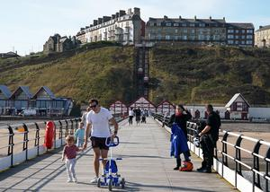 People enjoy the warm weather on the pier at Saltburn-by-the-Sea, North Yorkshire (Owen Humphreys/PA)