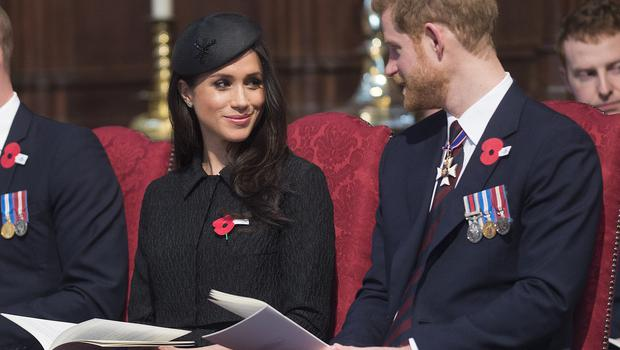 Meghan , with Harry during a service to commemorate Anzac Day, will become a British citizen (Eddie Mulholland/Daily Telegraph/PA)
