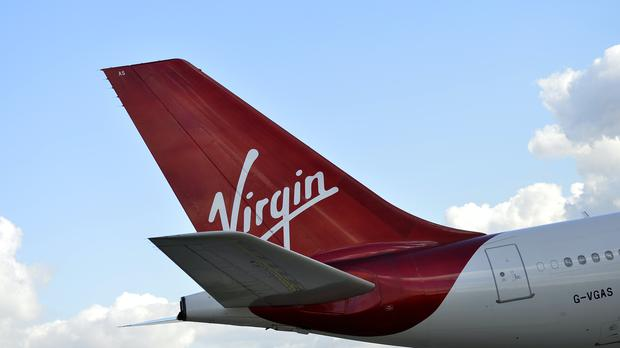 Virgin Atlantic has announced plans to cut 3,150 jobs at the airline (Hannah McKay/PA)