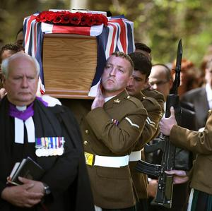 Soldiers carry the coffin at the funeral of Corporal William Savage in Glencorse Kirk