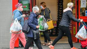 """Shoppers wear masks as they walk around the shops in Caerphilly centre as the county borough of Caerphilly in south Wales is under a local lockdown following a """"significant rise"""" in coronavirus cases. People are not allowed to enter or leave the area without a reasonable excuse after restrictions came into force at 6pm Tuesday August 8."""