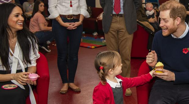 Poppy Dean gives a cake to the Duke of Sussex, during a visit to Broom Farm Community Centre in Windsor (Sgt Paul Randall/MoD/PA)