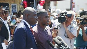 Quincy Mason, the son of George Floyd, talks to journalists (Jim Mone/AP)