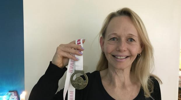 Tongue cancer survivor Karen Liesching-Schroder with her medal for the Southend Half Marathon 2016 which she ran two weeks after finishing radiotherapy (Beverley Rouse/PA)