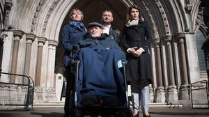 Noel Conway with his wife Carol (left), stepson Terry McCusker (centre back) and Sarah Wootton, CEO of Dignity in Dying (Stefan Rousseau/PA)