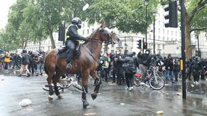 Mounted officers were brought in to police the demonstration (Yui Mok/PA)