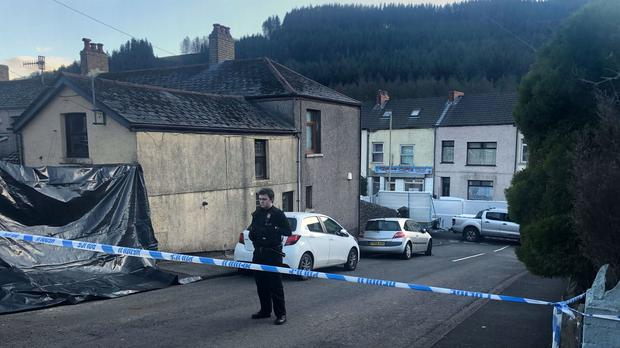 Police at the scene in the village of Ynyswen in Treorchy, Rhondda, after the death of Wenjing Xu (PA)