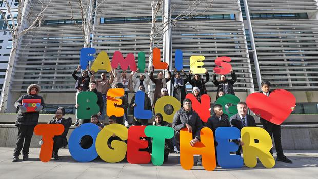 Children from Oaklands Secondary School in Bethnal Green and Families Belong Together campaigners outside the Home Office holding multi-coloured letters spelling out 'Families Belong Together' before handing a petition in, as they call on the government to amend the UK's refugee family reunion laws.