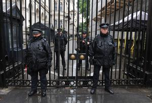 Police officers at the gates of Downing Street, central London (Nick Ansell/PA)