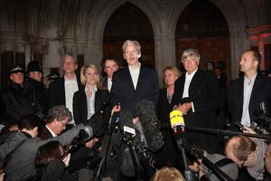 Assange outside the Royal Courts of Justice after a successful bail appeal in December 2010 (Peter Macdiarmid/PA)
