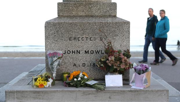 Floral tributes for Gaia Pope are left at the King Alfred Monument on the seafront in Swanage (Andrew Matthews/PA)