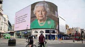 An image of the Queen and quotes from her broadcast in relation to the coronavirus crisis are displayed in London's Piccadilly Circus (Dominic Lipinski/PA)