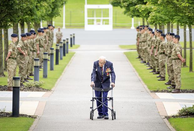 Captain Sir Tom Moore walking down a guard of honour during a visit to the Army Foundation College in Harrogate, where he was made an Honorary Colonel (Danny Lawson/PA)