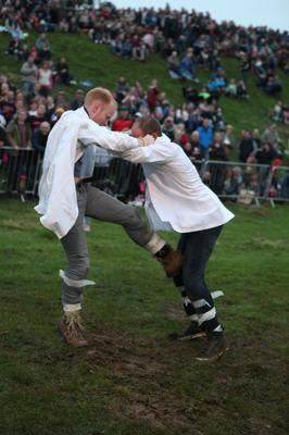 The shin-kicking championships, one of the events during the Cotswold Olimpicks 2014 (PA)
