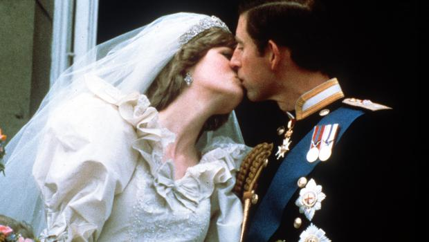 The Prince of Wales and his bride, Lady Diana Spencer, started the now traditional 'balcony kiss' (PA)