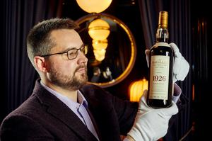 Whisky Auctioneer founder Iain McClune with the bottle of Macallan 1926 Fine and Rare 60 Year Old (Peter Dibden/Whisky Auctioneer/PA)