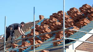 A roofer works on a property in Billericay, Essex (Nick Ansell/PA)