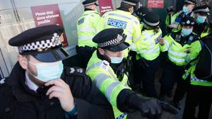 Police detain a person during an anti-lockdown protest in Clapham Common, London (Aaron Chown/PA)