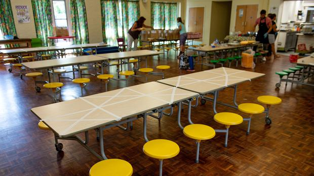 Tables are marked showing where children can sit during dinner time at Kempsey Primary School in Worcester. Nursery and primary pupils could return to classes from June 1 following the announcement of plans for a phased reopening of schools.
