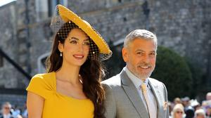 Amal and George Clooney will visit Edinburgh in March (PA)