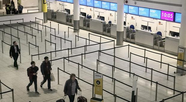 Empty check-in desks at Gatwick Airport after Monarch Airlines collapsed into administration (Lauren Hurley/PA)