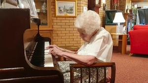 Rebecca Parker, 98, plays the piano at McClymont House care home in Lanark (NHS Lanarkshire/PA)