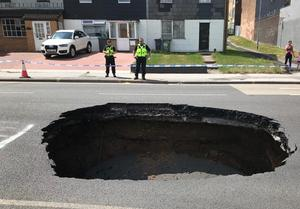 The sinkhole is four-metres (13ft) wide and three-metres (10ft) deep. (Walsall Council/PA)