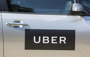 Uber rides are booked through a smartphone app (Laura Dale/PA)