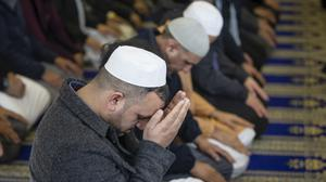 Worshippers take part in Friday Prayers at the Makkah Mosque in Leeds (PA)