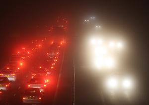 Traffic in the fog (Andrew Milligan/PA)