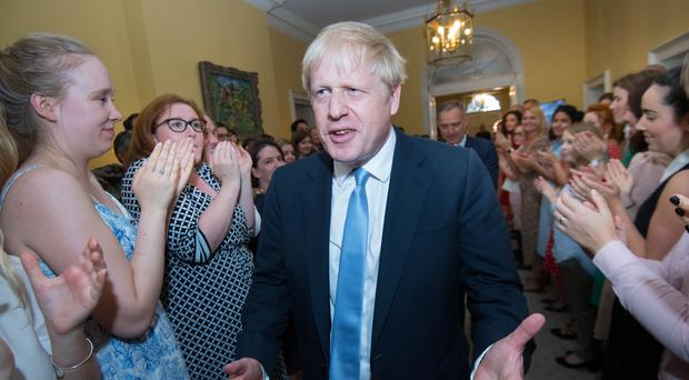 Prime Minister Boris Johnson is clapped into 10 Downing Street by staff (Stefan Rousseau/PA)