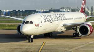 Virgin Atlantic is due to resume a host of routes in August (Steve Parsons/PA)