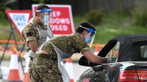 Members of the armed forces take swabs at a drive-in coronavirus testing facility at the Chessington World of Adventures Resort in south west London (Kirsty O'Connor/PA)